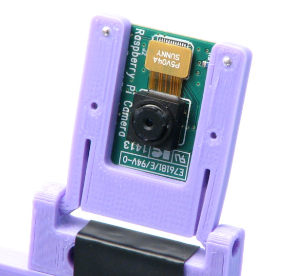 Attach camera to the base on its hinge